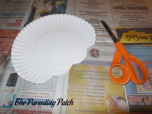 Cutting the Paper Plate for the I Is for Ice Cream Paper Plate Craft