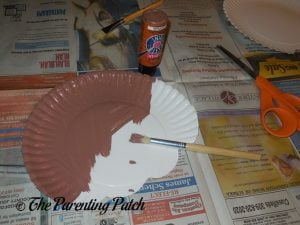 Painting the Paper Plate for the I Is for Ice Cream Paper Plate Craft