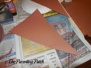 Cutting the Brown Paper for the I Is for Ice Cream Paper Plate Craft