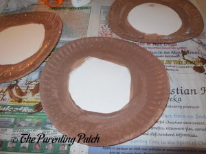 Painting the Edge of the Plate for the P Is for Pizza Paper Plate Craft