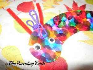 Adding Wiggle Eyes to the C Is for Caterpillar Paper Plate Craft