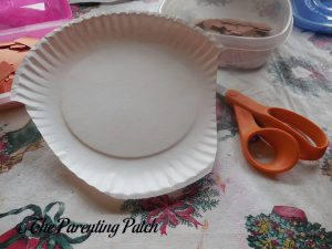 Cutting the Paper Plate for the A Is for Acorn Paper Plate Craft