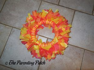 Foam Wreath Covered in Tablecloth Strips for the Tablecloth Strip Thanksgiving Wreath Craft