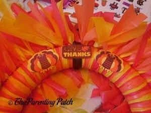 Gluing Decorations to the Tablecloth Ribbon Thanksgiving Wreath Craft