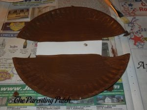 Painting the Plate Brown for the H Is for Hamburger Paper Plate Craft