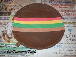 Gluing the Paper Strips on the H Is for Hamburger Paper Plate Craft