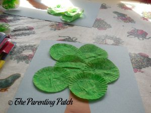 Gluing Green Cupcake Liners on the Cupcake Liner Apple Tree Craft