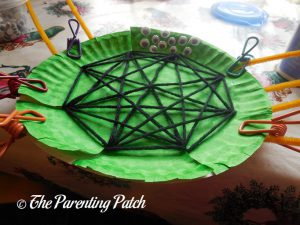 Finishing an S Is for Spider Halloween Paper Plate Craft