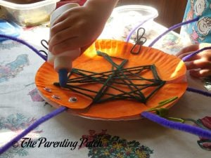 Finishing Another S Is for Spider Halloween Paper Plate Craft
