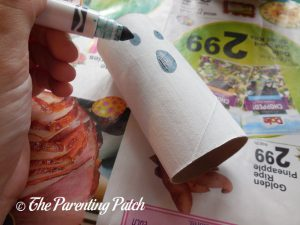 Drawing the Face on the Halloween Ghost Toilet Paper Roll Craft
