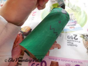 Drawing the Face on the Frankenstein's Monster Halloween Toilet Paper Roll Craft