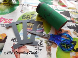 Cutting the Bolts for the Frankenstein's Monster Halloween Toilet Paper Roll Craft