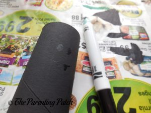 Drawing a Bat Face on the Black Bat Halloween Toilet Paper Roll Craft