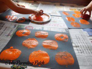 Stamping Apple Prints for the Apple Print Pumpkin Jack-o-Lantern Halloween Craft