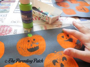 Adding Green Fingerprint Stems to the Apple Print Pumpkin Jack-o-Lantern Halloween Craft