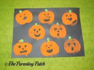 Completed Apple Print Pumpkin Jack-o-Lantern Halloween Craft