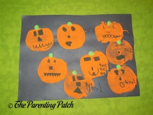 Apple Print Pumpkin Jack-o-Lantern Halloween Craft by First Grader