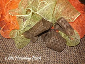 Brown, Green, and Orange on Deco Mesh and Burlap Ribbon Autumn Pumpkin Wreath Craft