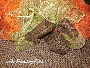 Brown, Green, and Orange on Deco Mesh and Burlap Ribbon Autumn Pumpkin Wreath Craft