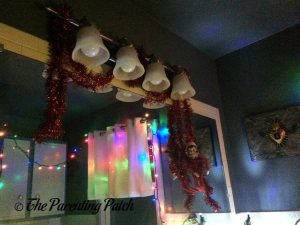 The Elf and the Garland on the Bathroom Lights 1