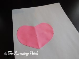Gluing the First Heart for the Heart Flamingo Valentine's Day Craft