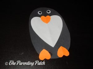 Gluing the Eyes on the Heart Penguin Valentine's Day Craft