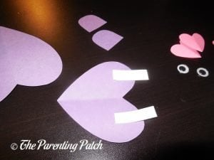 Gluing the White Lines on the Heart Hippo Valentine's Day Craft