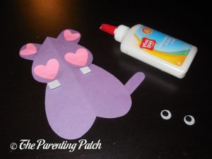 Gluing the Small Hearts on the Heart Hippo Valentine's Day Craft
