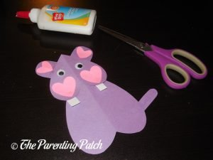 Gluing the Eyes on the Heart Hippo Valentine's Day Craft
