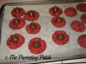 Chocolate Kisses for Peanut Butter Red Velvet Blossom Cookies