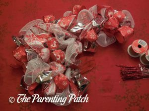 Fluffing the Deco Mesh, Ribbon, and Mesh Tube Candy Cane Christmas Wreath Craft