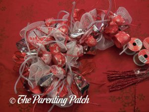 Finishing the Deco Mesh, Ribbon, and Mesh Tube Candy Cane Christmas Wreath Craft
